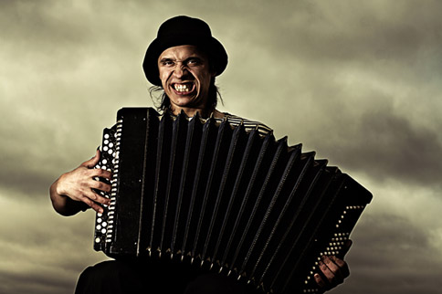 Gypsy Man playing the accordion